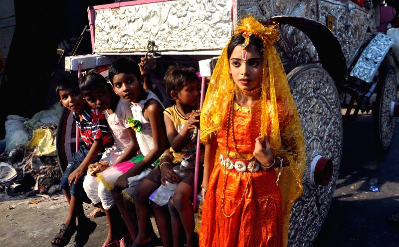 A child during 'Shiva Gajan' festival in Kolkata on April 13, 2014. The festival is celebrated in the last week of Chaitra and is said to be more than 300 years old.