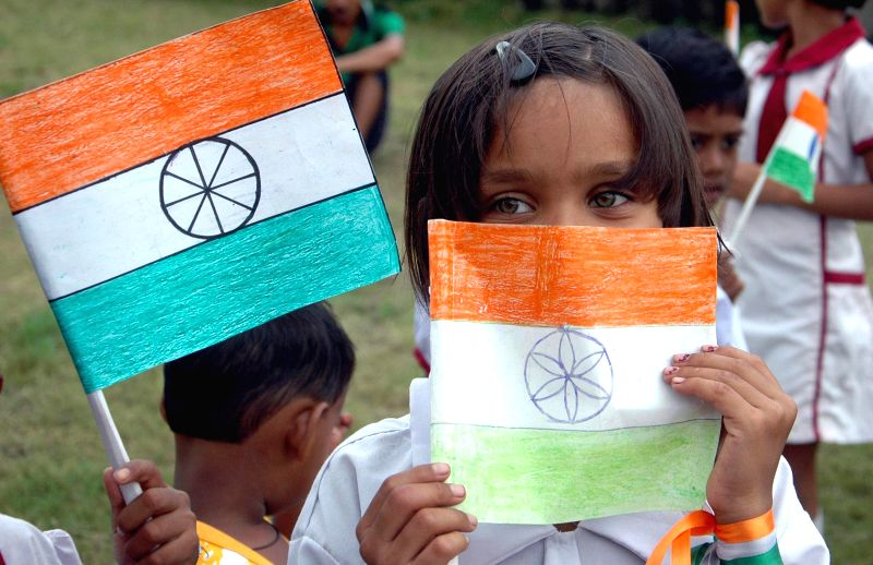 A child hold national flag as she celebrates Independence Day in Kolkata on Aug 15, 2014.