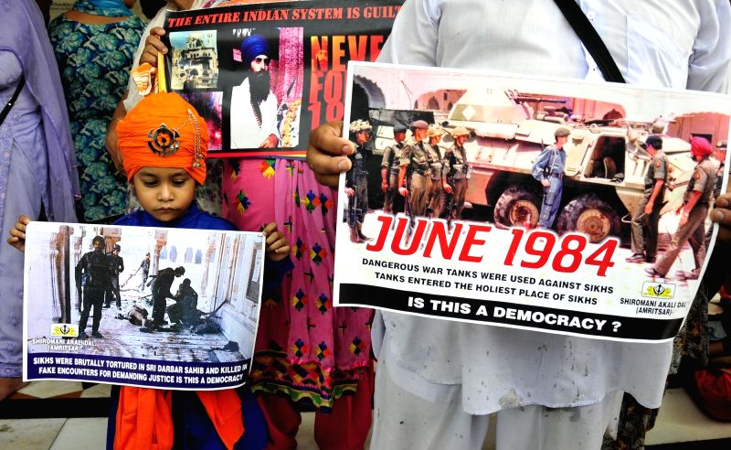 A child holds a poster against Operation Bluestar during a programme organised to  pay tribute to those killed in the operation  in Amritsar, on June 6, 2017.