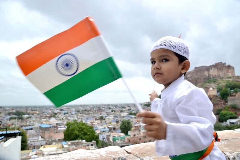 A child holds the Indian flag during a programme organised to celebrate Independence Day in Jodhpur