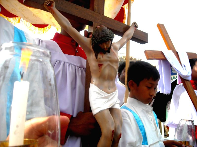 A child participate in a Good Friday procession organised in Agartala on April 18, 2014.