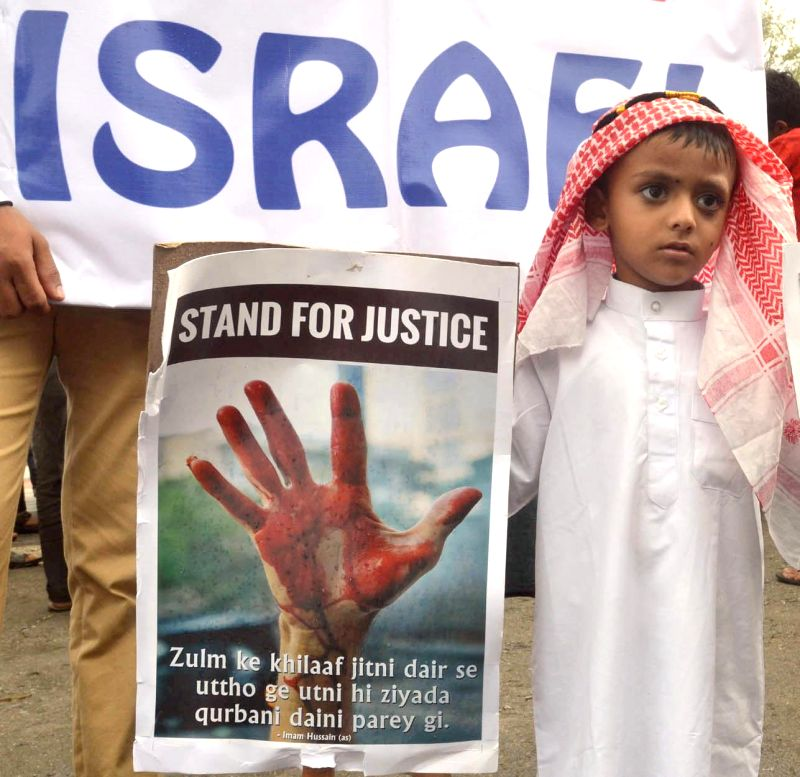 A child participates in a demonstration against Israeli attacks on Gaza in Bangalore on July 27, 2014.