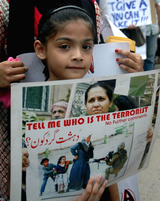 A child participates in a rally organised by Jadavpur University students against Israeli attacks on Gaza in Kolkata on Aug 5, 2014.