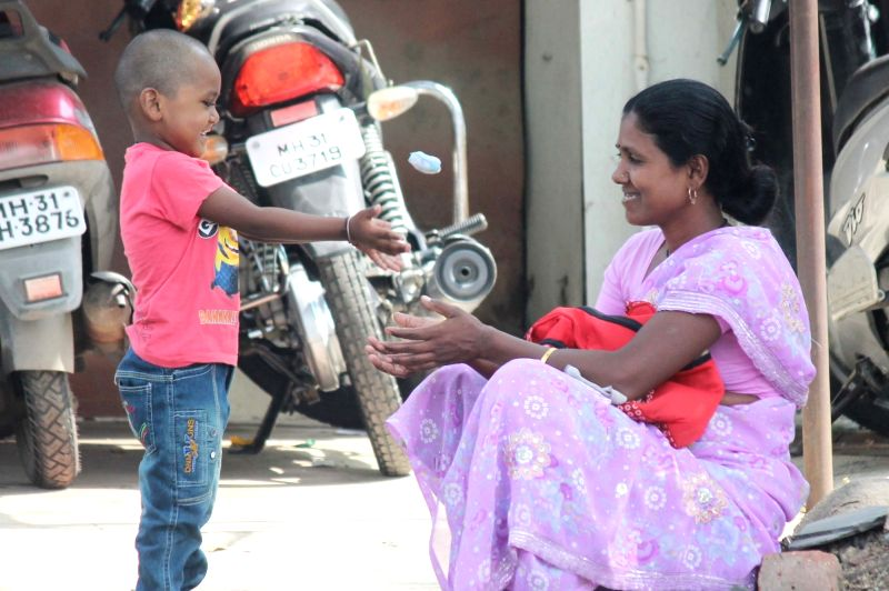 A child plays with his mother in Nagpur, on May 8, 2016. 8th May is observed as Mother's Day across the world.