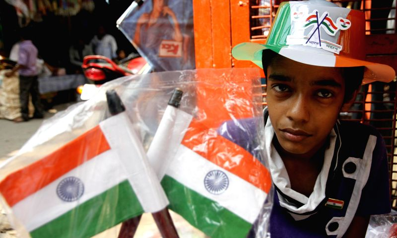 A child sells Indian flags ahead of Independence Day in New Delhi on Aug 11, 2014.