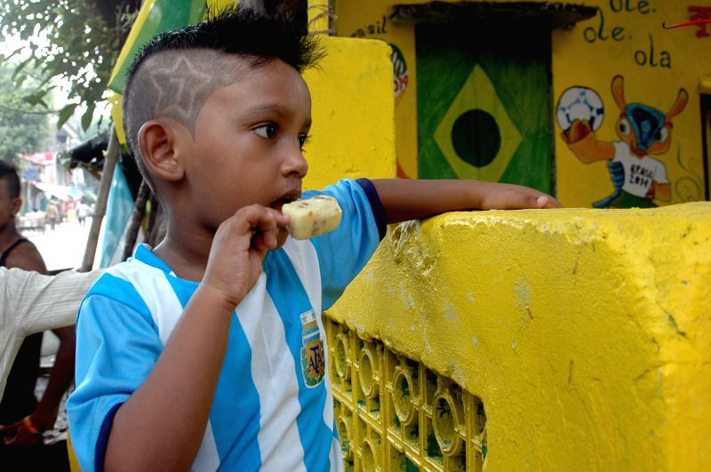 A child wearing a jersey of Argentine football team in Kolkata on July 1, 2014.