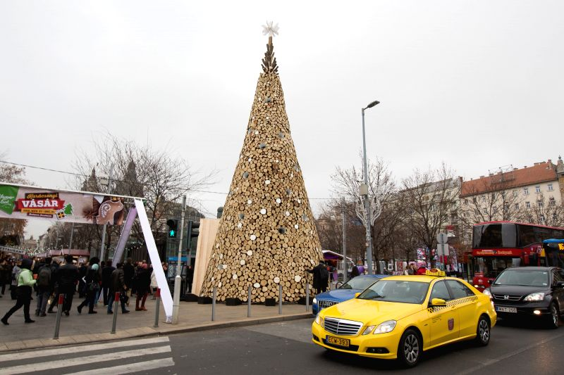 A Christmas tree built of firewood is seen on Elizabeth Square in Budapest, Hungary, on Dec. 8, 2015. This Christmas tree is 16 meters high and is made of 40 tons ...