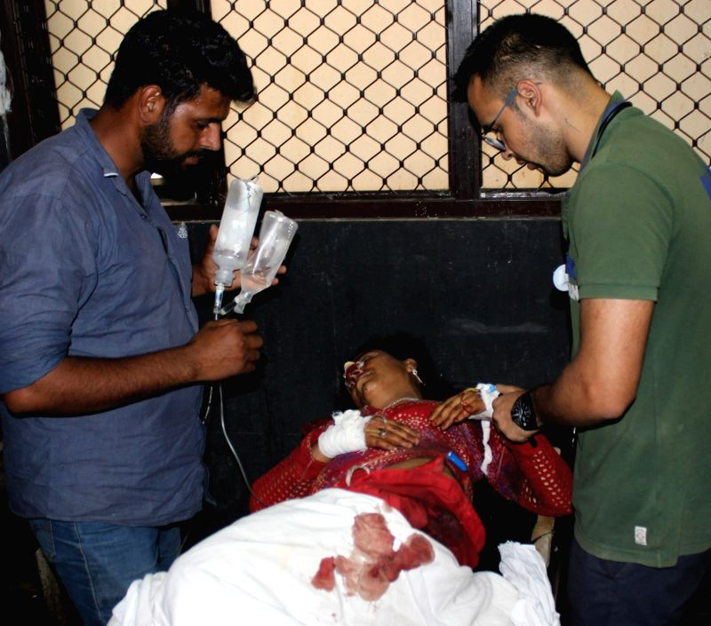 A civilian who was injured being treated at a GMC hospital after Pakistani army fired mortar bombs along the Line of Control (LoC) in Jammu and Kashmir's Rajouri district; in Jammu on May 13, ...