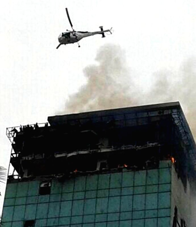 A coast guard helicopter which was pressed into service to rescue people trapped in the 22-storeyed Lotus Park building where a fire broke out on July 18, 2014. A fireman was killed and five others ..