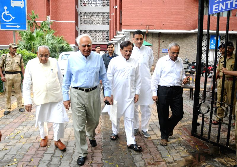 A Congress delegation comprising of Kapil Sibal, Motilal Vora, Ahmed Patel and Randeep Singh Surjewala come out of Nirvachan Sadan after meeting the Chief Election Commissioner in New Delhi on May 5, - Ahmed Patel and Randeep Singh Surjewala
