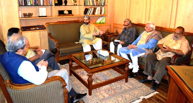A Congress party delegation led by Mani Shankar Aiyar calls on senior Kashmiri separatist leader Mirwaiz Umer Farooq in Srinagar on May 25, 2017. The delegation includes O.P. Shah, Santosh ... - P. Shah