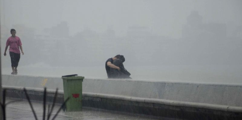 A couple gets romantic during rains at Marine Drive in Mumbai on July 7, 2014.