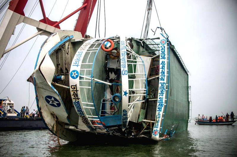 A crane lifts MV Miraj-4 which had capsized in the Meghna river near Daulatdia in Munshiganj of Bangladesh on 15th May, on May 17, 2014.