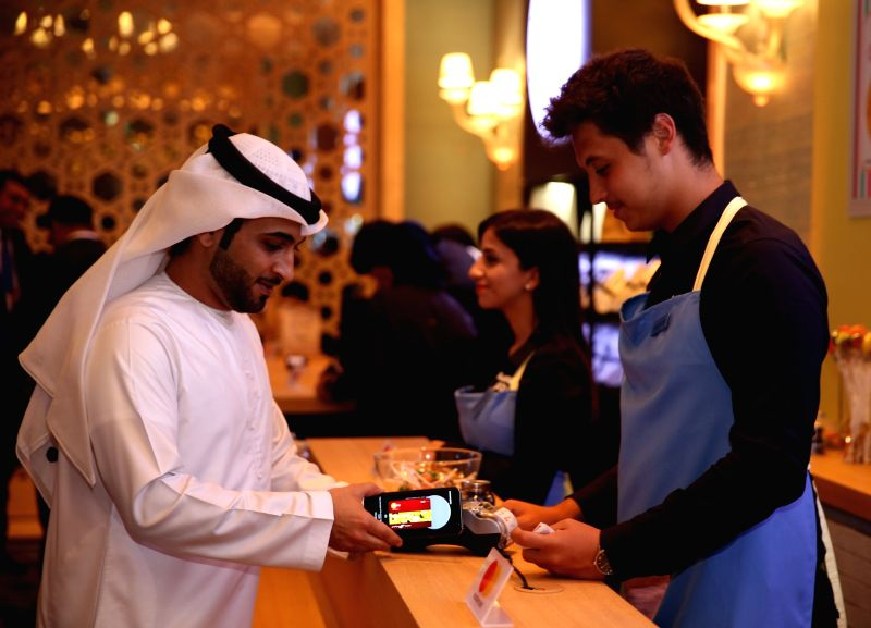A customer tries Samsung Electronics Co.'s mobile payment service Samsung Pay during a launch ceremony in Dubai on April 27, 2017, in this photo provided by Samsung the next day.