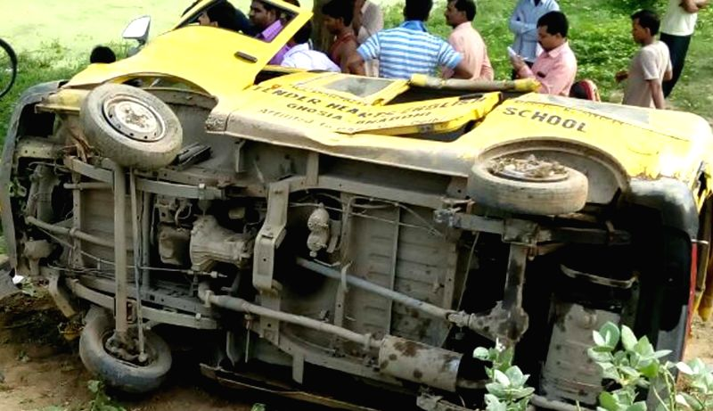 A damaged school van which was hit by a passenger train at an unmanned crossing in Uttar Pradesh's Bhadohi district killing 10 children and injuring nine; in Varanasi on July 25, 2016.