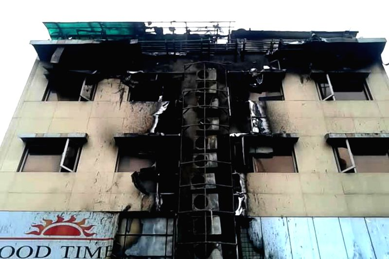 A defaced view Waton Hotel where a fire broke out in Navi Mumbai on Aug 8, 2014. Reportedly one person was killed and 30 others were injured in the fire.