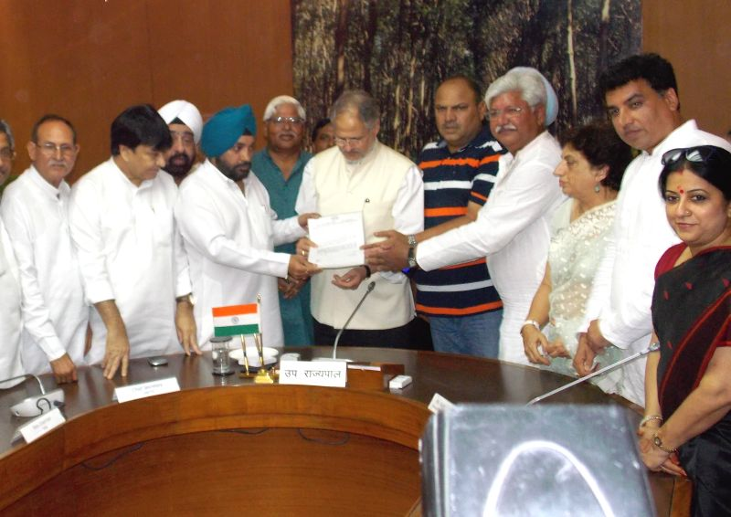 A delegation led by Delhi Congress chief Arvinder Singh Lovely meets Delhi Lt Governor Najeeb Jung in New Delhi on August 1, 2014. - Arvinder Singh Lovely