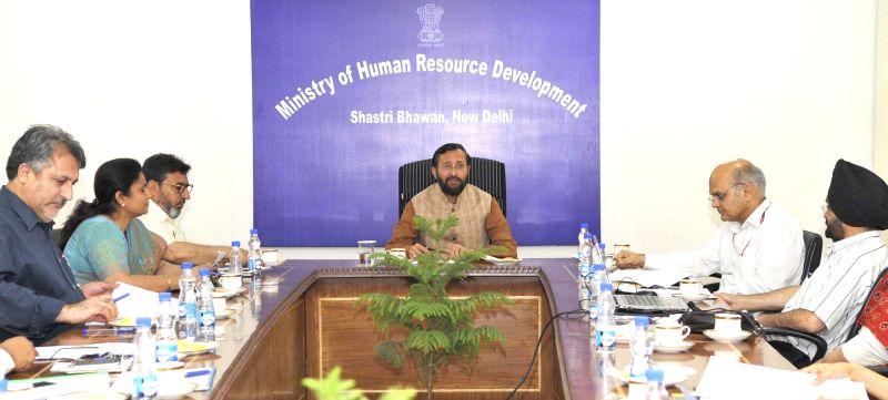 A delegation led by Jammu and Kashmir Education Minister Syed Mohammad Altaf Bukhari calls on Union HRD Minister Prakash Javadekar in New Delhi on May 3, 2017. - Syed Mohammad Altaf Bukhari