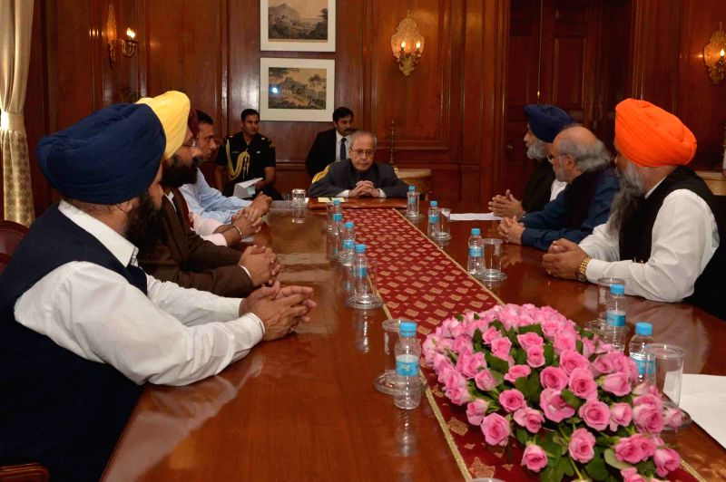 A delegation led by Punjab Deputy Chief Mininster Sukhbir Singh Badal calls on the President Pranab Mukherjee at Rashtrapati Bhavan in New Delhi on Nov 21, 2015. - Pranab Mukherjee