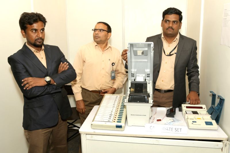 "A demonstration of Electronic Voting Machines and Voter-verifiable paper audit trail (VVPAT) underway during a press conference on ""EVM Challenge"" called by Election Commision in ..."