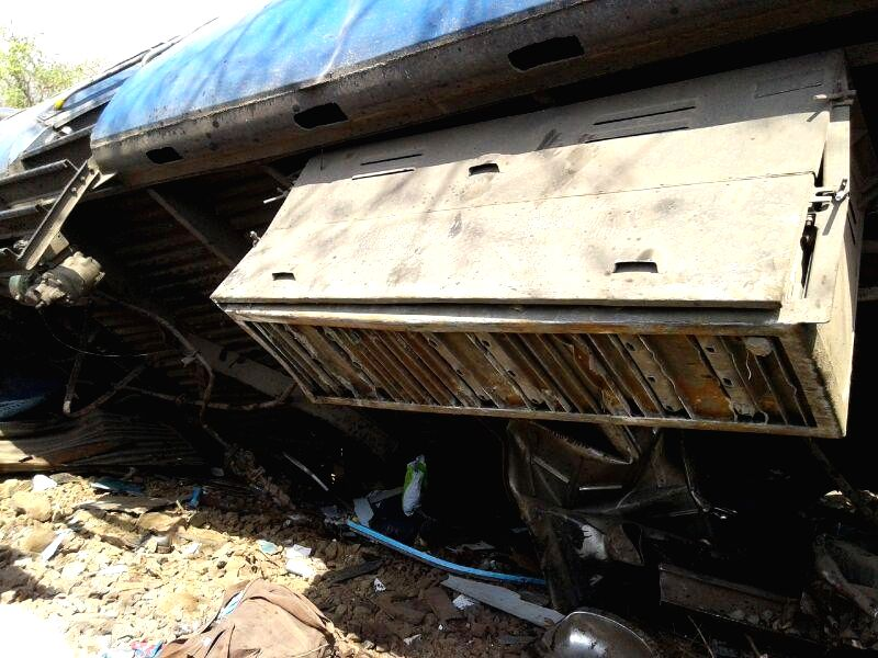 A derailed coach of Diva-Sawantwadi express near Nagothana in Raigarh of Maharashtra on May 4, 2014. The engine and four coaches of  the train were derailed. Three people are feared dead.