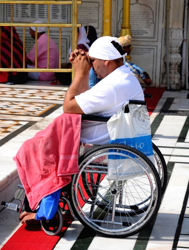A differently-abled devotee pays obeisance at Golden Temple on the occasion of Baisakhi, in Amritsar on April 14, 2018.