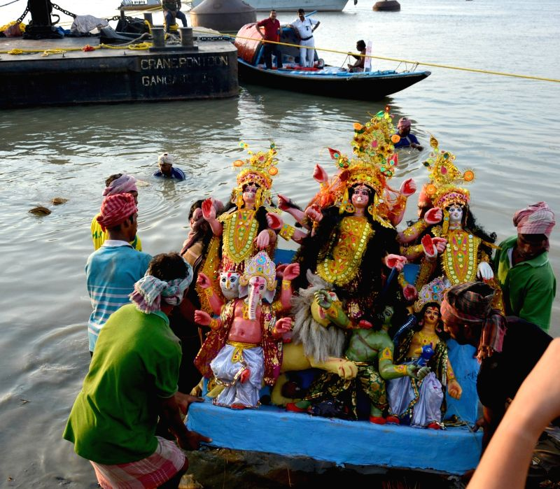 A Durga idol being immersed in Hooghly river after Durga Puja in Kolkata.