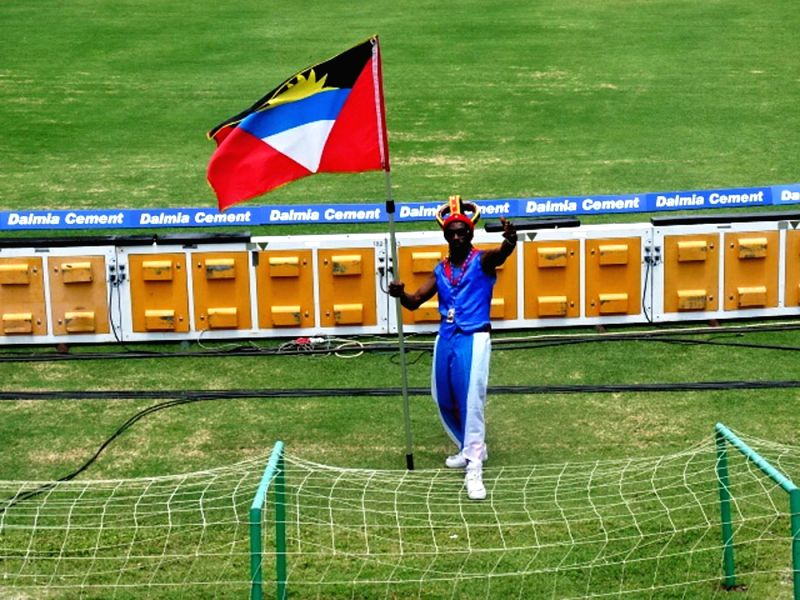 A fan cheers during the first test match between India and West Indies at Sir Vivian Richards Stadium in Antigua on July 22, 2016.