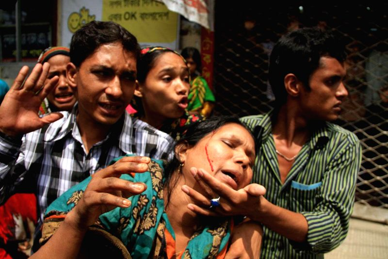 A female worker of Tuba Group gets injured during a police drive to evict protesters from a Badda factory where they were holding a hunger strike in Dhaka, Bangladesh on Aug 7, 2014.