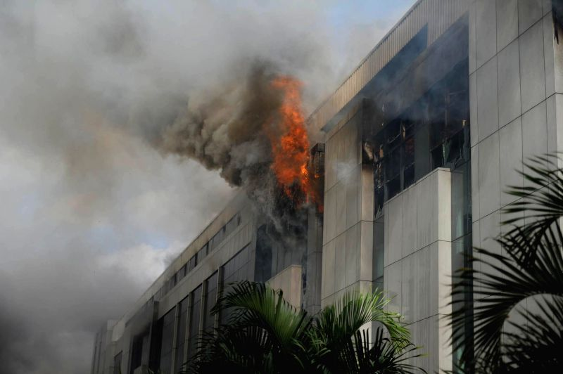 A fire breaks out at AMR Tech Park which engulfed all the four floors of the building in Bangalore on July 18, 2014.
