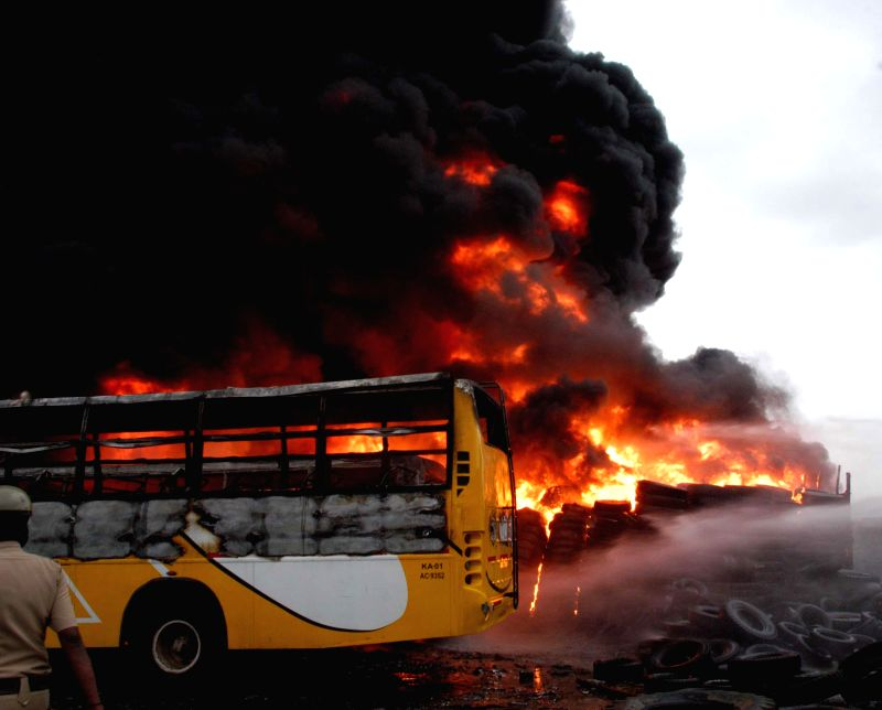 A fire breaks out at an old bus depot near TR Mills, Chamrajpet, in Bangalore on Aug 3, 2014.