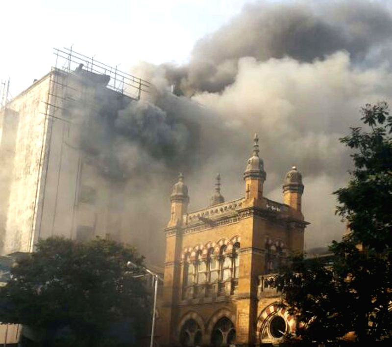 A fire breaks out at the fifth floor of the Central Railway administrative building next to the CST Railway Station in Mumbai on June 27, 2014. At least eight fire tenders rushed to the spot and were