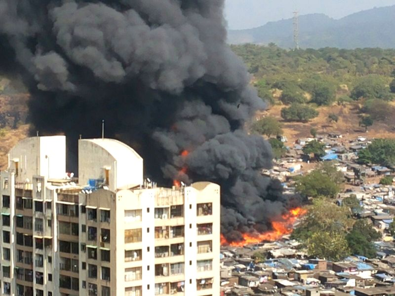 A fire breaks out in a northwest Mumbai slum on Dec 7, 2015.  Two people, including a child, were burnt to death and 11 others, including three women, suffered injuries in the fire that led ...