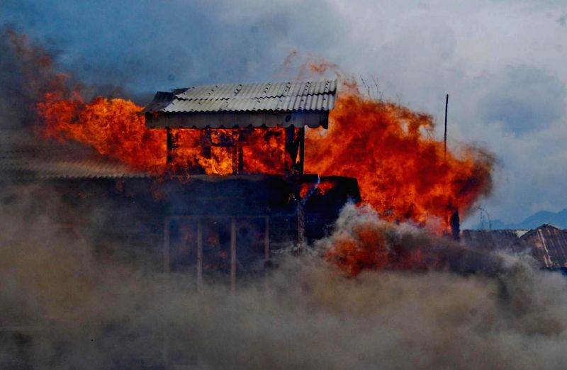 A fire breaks out in a residential area of Srinagar on May 11, 2014. Several houses were gutted in the fire.