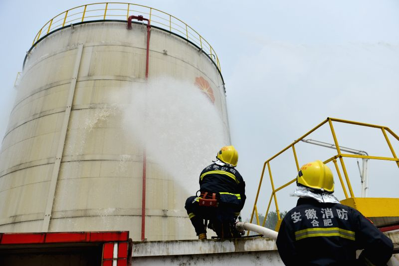 A fire drill is held at an oil depot in Daxing Town of Hefei, capital of east China's Anhui Province, Aug. 17, 2015.