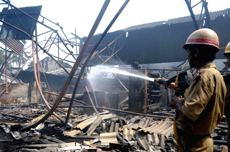 A firefighter douses a fire that broke out at a thermocol factory in West Bengal's Howrah district on April 20, 2017.