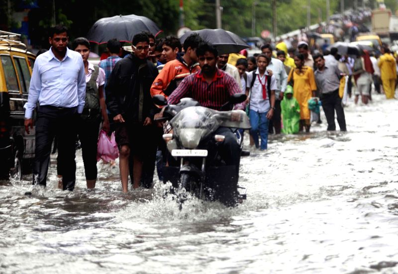 A flooded street of Mumbai after heavy rains in Mumbai on July 16, 2014.