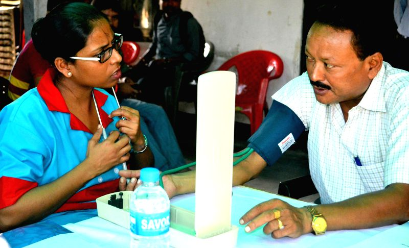 A free medical check-up camp for the journalists and their family in Guwahati on Aug 28, 2014. (Photo: IANS) `