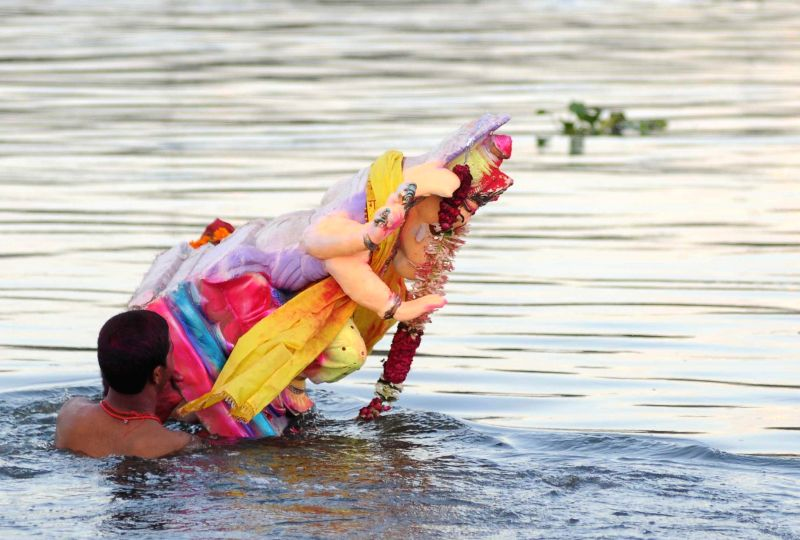 A Ganesh idol being immersed in the  Yamuna river near ITO in New Delhi on Sept. 1, 2014.