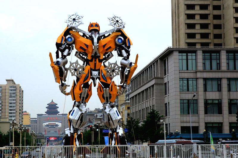 """A gigantic transformer """"Bumblebee"""" stands at the China Millennium Monument Square in  Beijing, capital of China, July 14, 2015. The 12-meter-high ..."""