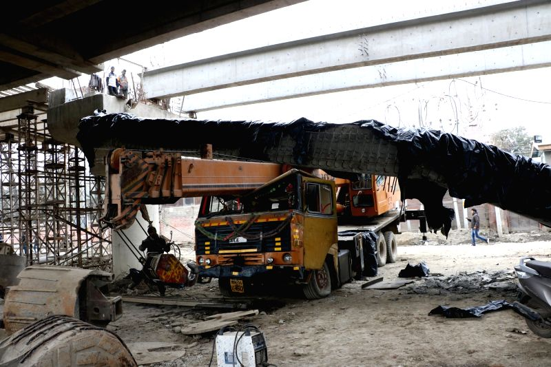 A girder from the under-construction Srinagar flyover near Solina came down crashing on a crane beneath it after an earthquake jolted Jammu and Kashmir on Jan 31, 2018.