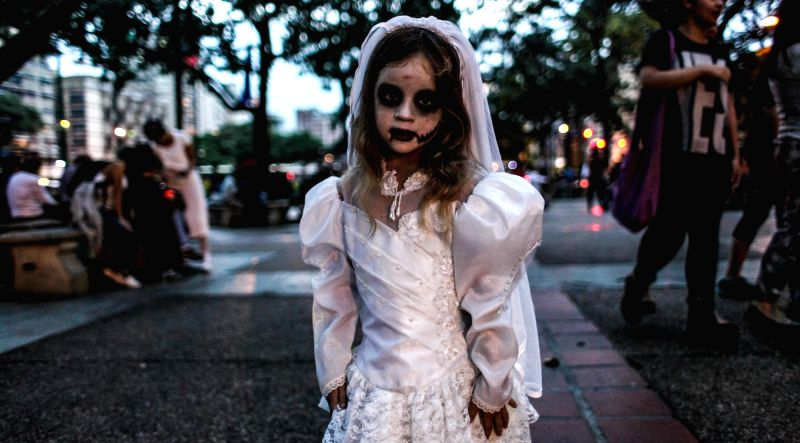 A girl attends a Zombie March, held during the Halloween celebration, at Plaza Altamira of Caracas, Venezuela, on Oct. 31, 2015.