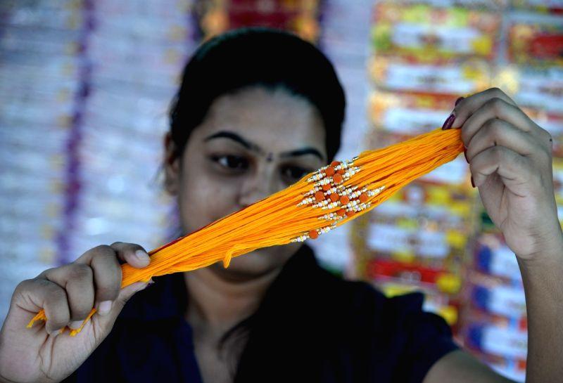A girl busy with Rakhi shopping ahead of Raksha Bandhan in Bengaluru on Aug 5, 2017.