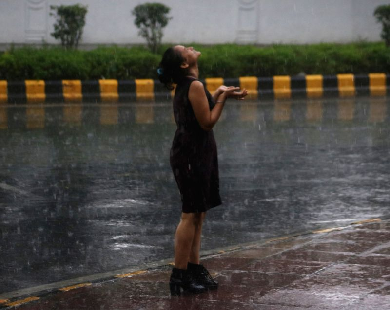 A girl enjoys during rains, in New Delhi on July 16, 2018.