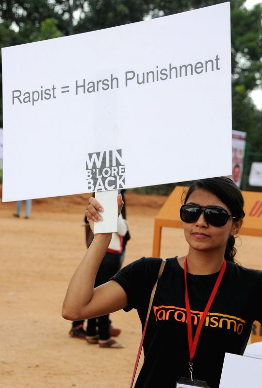 A girl participates in a demonstration against  crime against women in Bangalore on July 20, 2014.