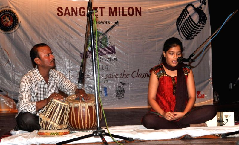 A girl sings during the auditions of 'Classical Voice of India 2014' at district library auditorium in Guwahati on May 18, 2014.