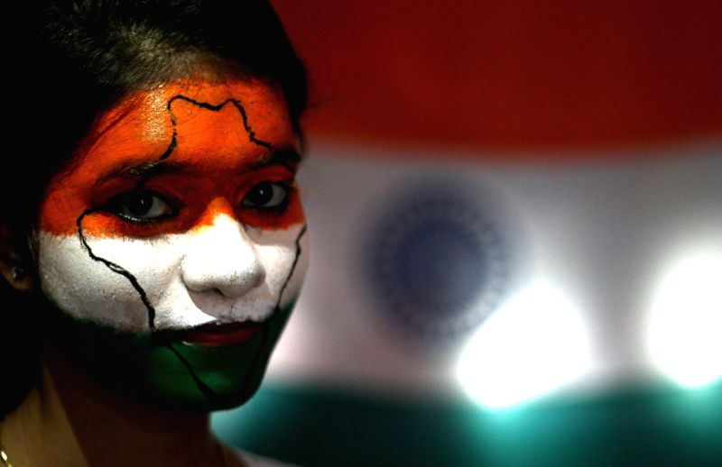 A girl with the Indian map painted on her face in tricolour celebrates Independence Day in Chennai