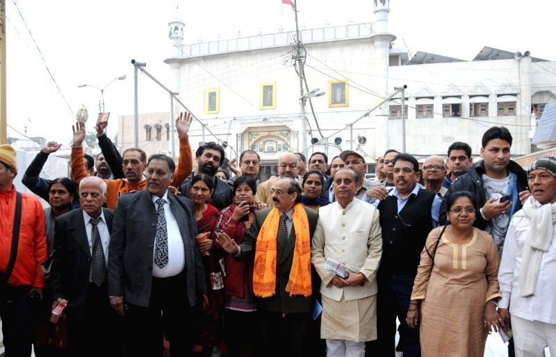 A group of Hindu pilgrims before leaving for Katasraj temple (Pakistan) at Durgiana Temple in Amritsar on Dec 10, 2015.