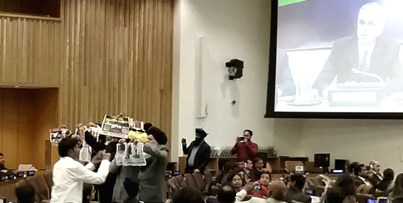 A group of Sikhs held up protest posters and turned their back on India's Permanent Representative Syed Akbaruddin as he spoke at BR Ambedkar's birth anniversary celebrations at the United Nations on ...
