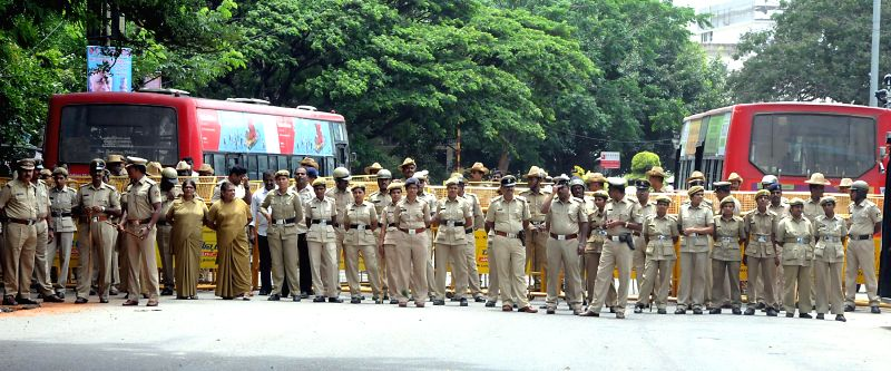 A heavy police contingent deployed near Karnataka Chief Minister Siddaramaiah's residence in wake of BJP Yuva Morcha's demonstration against alleged rape of a 6-year-old student in Bangalore on July . - Siddaramaia